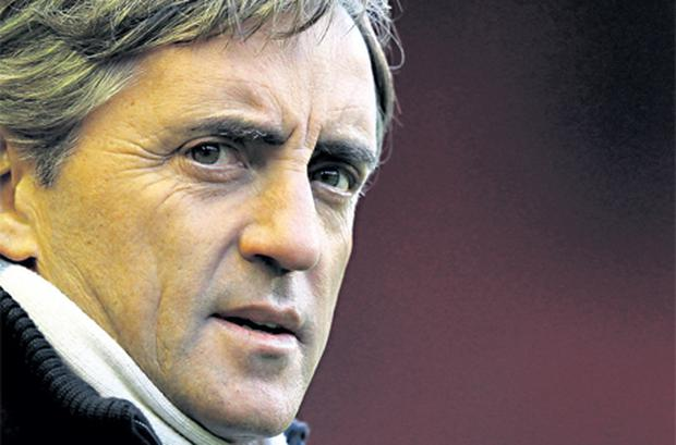 Roberto Mancini: under huge pressure to deliver for their mega-rich owners