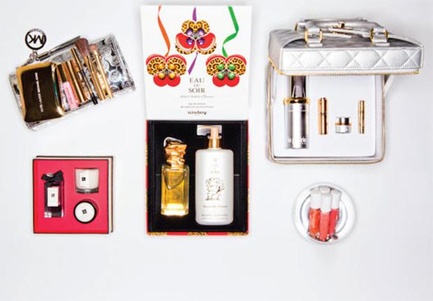 Pictured, clockwise from bottom left: Jo Malone Christmas Pampering Collection; Michael Kors for Estee Lauder Cosmetics Bag; Sisley Eau de Soir Set; La Prairie Radiance Wonders Set; Mac Dazzlesphere! Coral Ornament