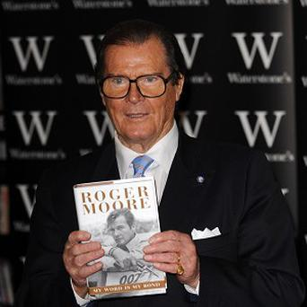 Actor Sir Roger Moore says he has paid his fair share of taxes in the UK and denied he was being unpatriotic by living abroad