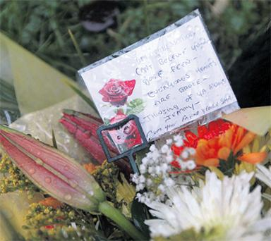 Floral tributes are left at the scene of the killing in a quiet Dundalk housing estate