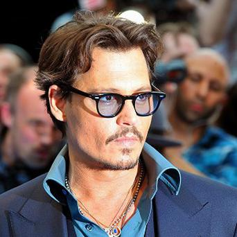 Johnny Depp has been named the movie star who the nation would most like to pop round for Christmas