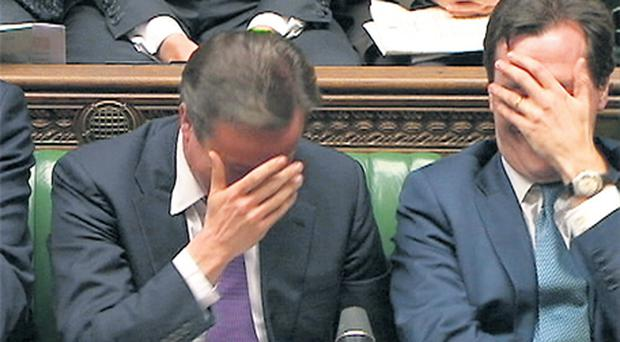 Britain's Prime Minister David Cameron (left) reacts with Chancellor of the Exchequer George Osborne during a Commons debate on last week's European Union summit