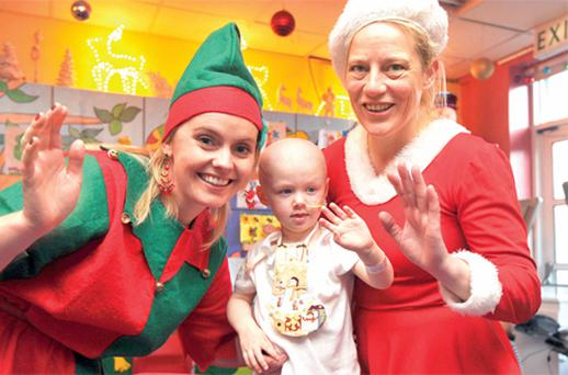 Charlotte Butler (2) with Mrs Claus, Janne McAleer, and Claire Dixon
