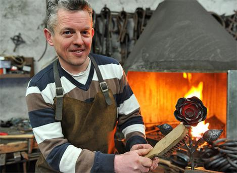 Blacksmith Gerard Loughran with his rose for the Norwegian memorial