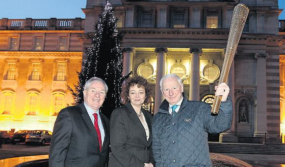 IOC head Pat Hickey, Michael Ring, and Caral Ni Chuilin with the replica Olympic torch yesterday