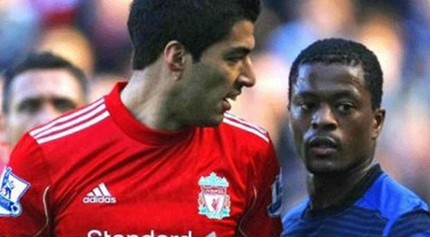 Lost in translation: Patrice Evra (right) and Luis Suárez during controversial clash. Photo: AP