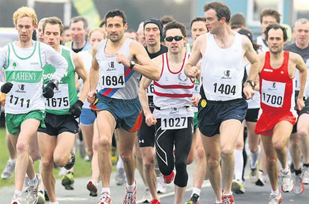 Competitors including eventual winner Tommy Evans (1700, right) at the start of the Aware Christmas 5Mile run in the Phoenix Park last weekend