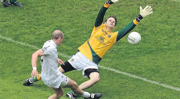 Meath goalkeeper Brendan Murphy saves a shot from Kildare's James Kavanagh during their Leinster SFC clash in June