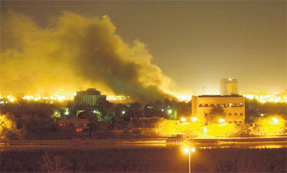 Smoke rises from one of Saddam Hussein's palaces in Baghdad at the start of the war