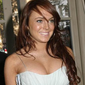 A judge has praised actress Lindsay Lohan for sticking to the strict new terms of her probation