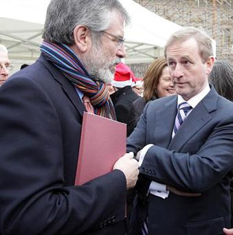 Taoiseach Enda Kenny has accused Gerry Adams of IRA membership