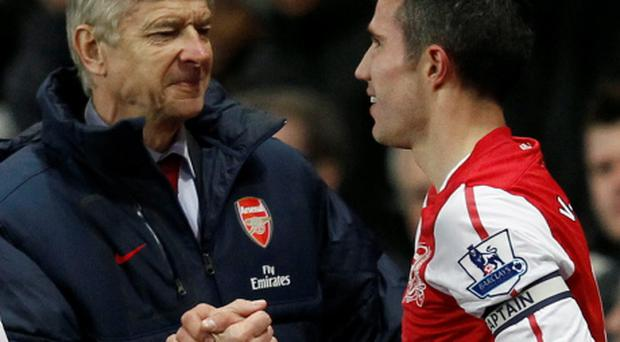 Robin Van Persie (R) and Arsene Wenger when they were both with Arsenal