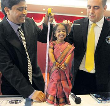 Jyoti Amge is measured by a local doctor, K Sujatha, and Guinness World Records adjudicator Rob Molloy. Photo: REUTERS