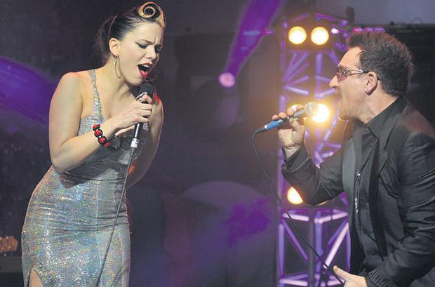 DOUBLE TROUBLE: Imelda May is joined on stage by U2 frontman Bono at The O2 in Dublin on Friday night. Photo: John Dardis