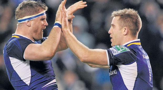 Jamie Heaslip and Luke Fitzgerald celebrate Leinster's second try against Bath at the Aviva Stadium last night. Photo: Stephen McCarthy
