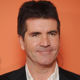 Simon Cowell's ability to spot a potential music hit could soon be challenged by a computer programme
