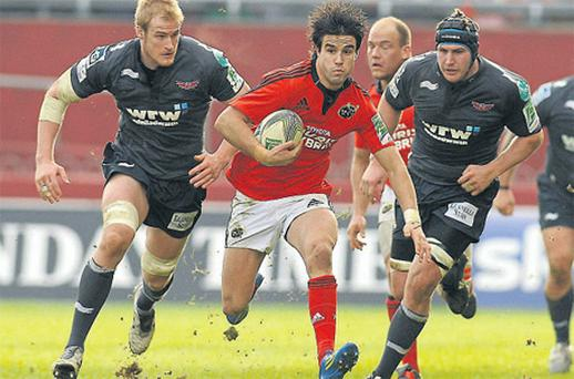 Munster's Conor Murray gets away from Damian Welch, left, and Ben Morgan