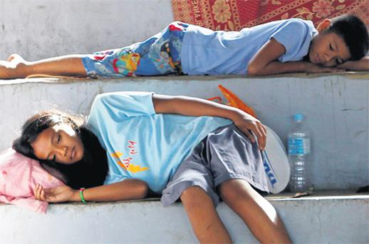 Typhoon Washi victims left homeless rest in an evacuation centre in Cagayan de Oro, southern Philippines yesterday