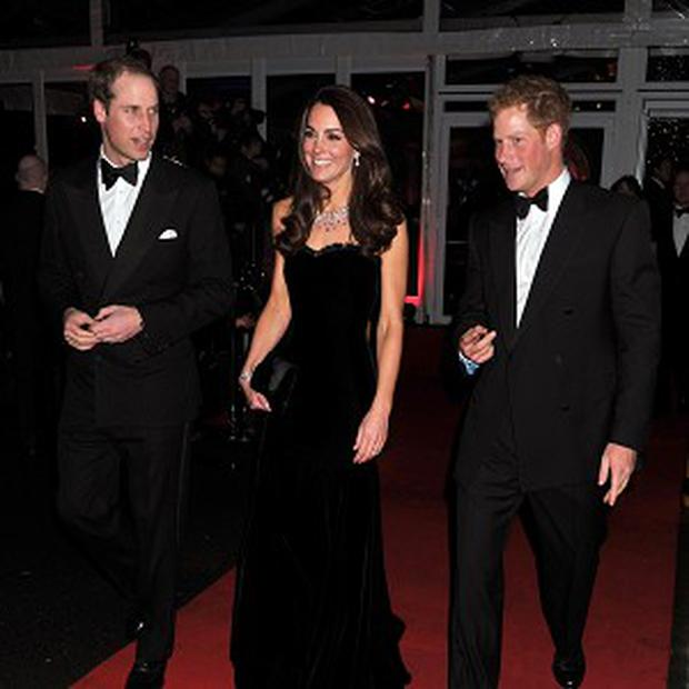 The Duke and Duchess of Cambridge and Prince Harry at the Imperial War Museum in London