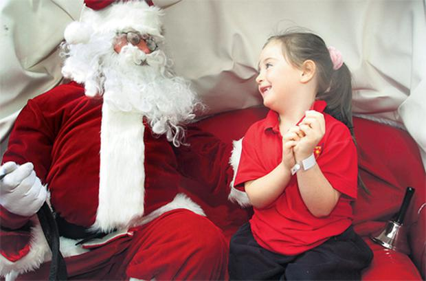 Five-year-old Abbey Faye, from Ballyfermot, Co Dublin, pictured with Santa outside Crumlin Children's Hospital. Photo: Frank McGrath