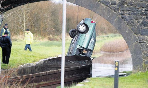 The car in which Beena Jacobs lost her life is removed from the canal at Clononey, Co Offaly, yesterday