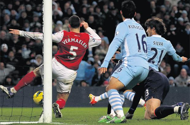 David Silva pounces to score the winning goal for Manchester City against Arsenal on Sunday