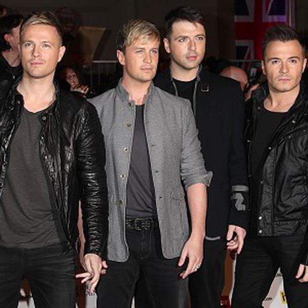 Westlife said Louis Walsh tried to talk them out of the split