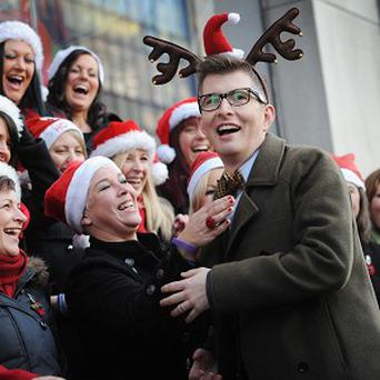Gareth Malone with the Military Wives choir in London's Oxford Street