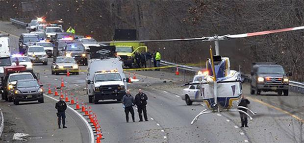 A State Police helicopter lands on the southbound lanes of route 287 in Harding Township, where a small plane headed for Georgia crashed