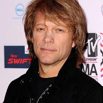 Jon Bon Jovi is alive and well, he has told his fans