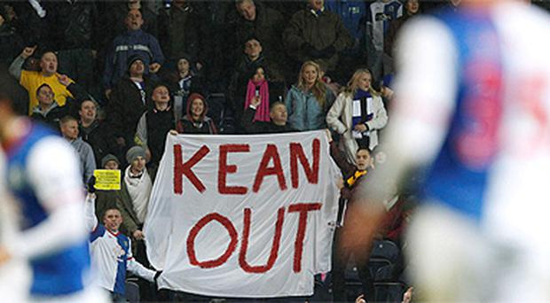 Blackburn Rovers fans hold a banner calling for the manager Steve Kean to go