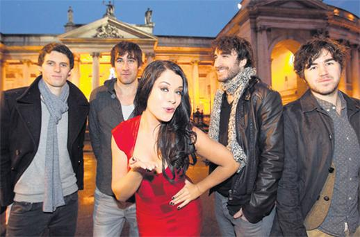 Michele McGrath and The Coronas (from left, Conor Egan, Dave McPhillips, Danny O'Reilly and Graham Knox) at the launch yesterday of the New Year's Eve Countdown Concert in Dublin