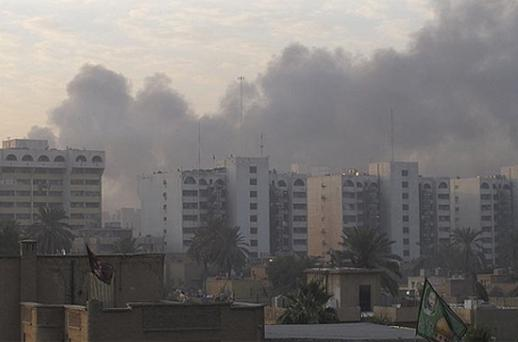 Smoke rises from the site of a bomb attack in central Baghdad December 22, 2011. Photo: Reuters