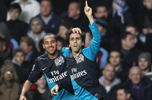 Arsenal's Yossi Benayoun celebrates his goal with team mate Theo Walcott. Photo: Getty Images