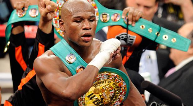 Floyd Mayweather jnr celebrates his fourth-round knockout of Victor Ortiz to win the WBC welterweight title September 17. Photo: Getty Images