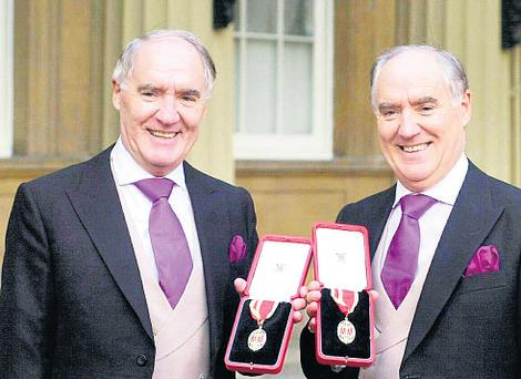 The multi-millionaires Sir David Barclay (left) and his twin brother Sir Frederick after receiving their knighthoods