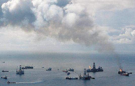 Smoke rises from the BP oil spill site, as natural gas is burned off, while two relief wells were drilled during the Gulf of Mexico disaster. Photo: Reuters