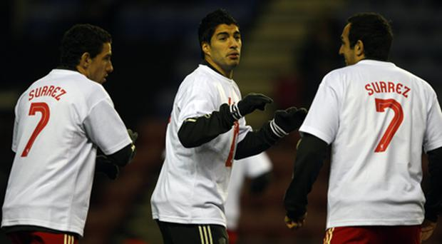 Liverpool team-mates show support for Suarez before last night's game. Photo: Getty Images