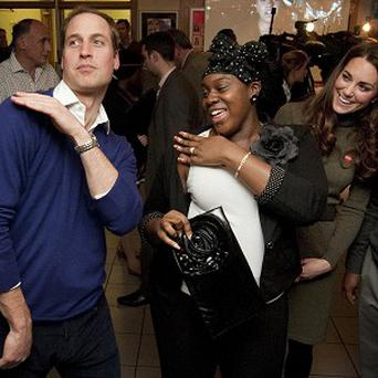 The Duke of Cambridge dances with Vanessa Boateng during a visit to Centrepoint's Camberwell Foyer in London