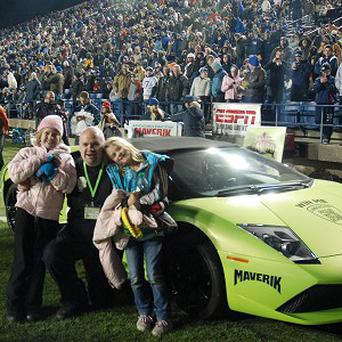 David Dopp posing with his daughters after winning a Lamborghini, which he crashed six hours later (AP/Maverik)