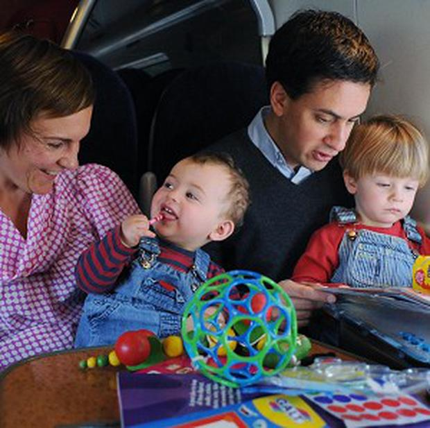 Family photoshoots of politicians, such as this one with Labour leader Ed Miliband and his family, have been criticised by colleague Ed Balls