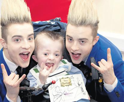 Michael Stokes (9) hangs out with Jedward at Temple Street Children's Hospital yesterday