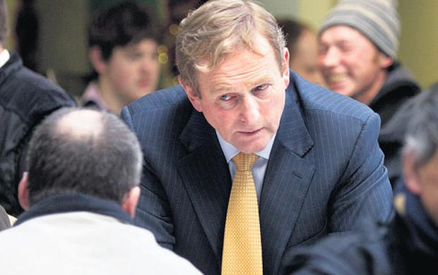Enda Kenny talks to a man in the dining hall at Capuchin Day Centre
