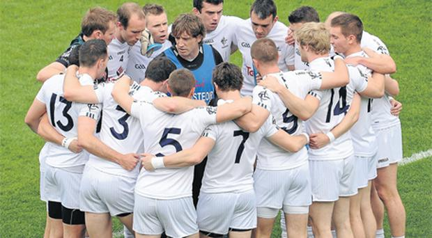 Kieran McGeeney stands at the centre of the Kildare team before this year's All-Ireland quarter-final against Donegal