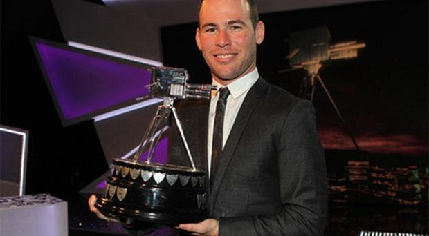 Mark Cavendish with the BBC Sports Personality of the Year trophy. Photo: PA