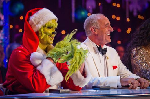 Strictly Come Dancing judge Craig Revel Horwood dressed as the Grinch next to fellow judge Len Goodman. Photo: PA