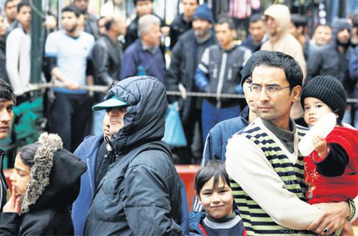 People wait in line to receive food from the Orthodox Church of Greece in Athens yesterday. Poverty has visibly increased on the streets of the capital of four million, where people huddle in sleeping bags in empty alleys and can be seen rummaging through garbage containers, looking for food or scraps of metal or glass to sell. Photo: Reuters