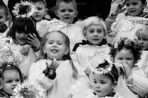 NO CRIB FOR A BED: The Christmas story tells us of a family's need for a roof over their heads - something the Government would forget at their peril. Above, children from St Josephs Nursery, Dublin, all dressed as angels to sing Christmas carols at the Live Animal Crib at the Mansion House in Dublin. Photo: Neil Carson