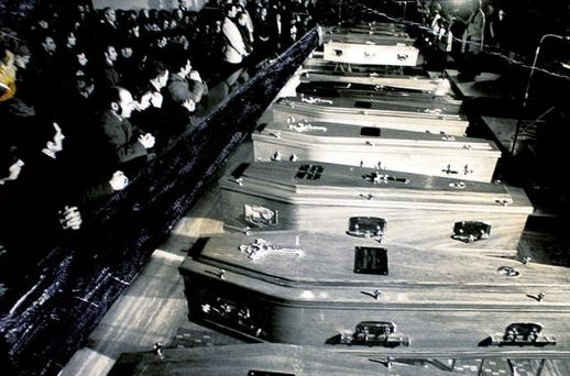 People pray over the coffins of Derry's Bloody Sunday victims in 1972.