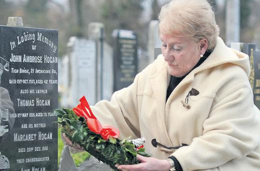 Still grieving: Mary Nolan visits the grave of her adored daughter Aine, who died aged one month. Photo by Dave Meehan